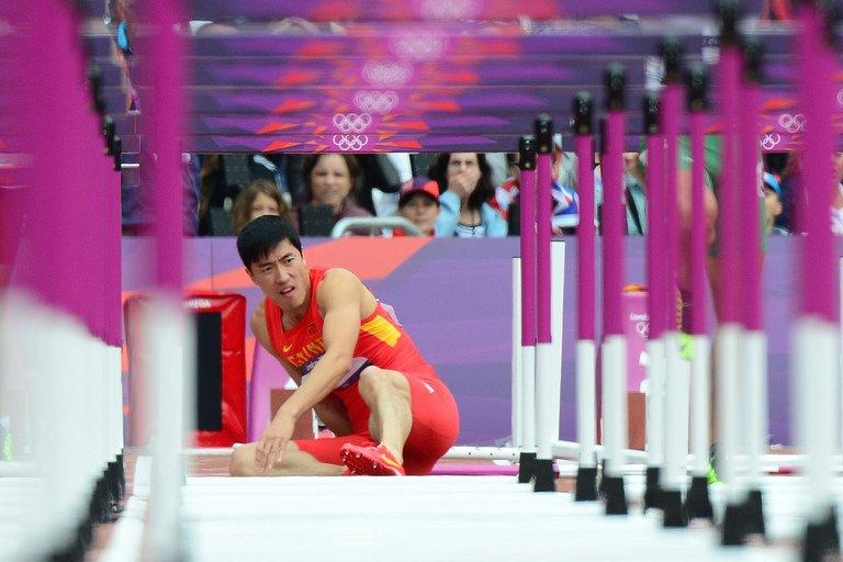 China's Liu Xiang falls at the first hurdle during the London Olympics 110m opening heat on August 7, 2012