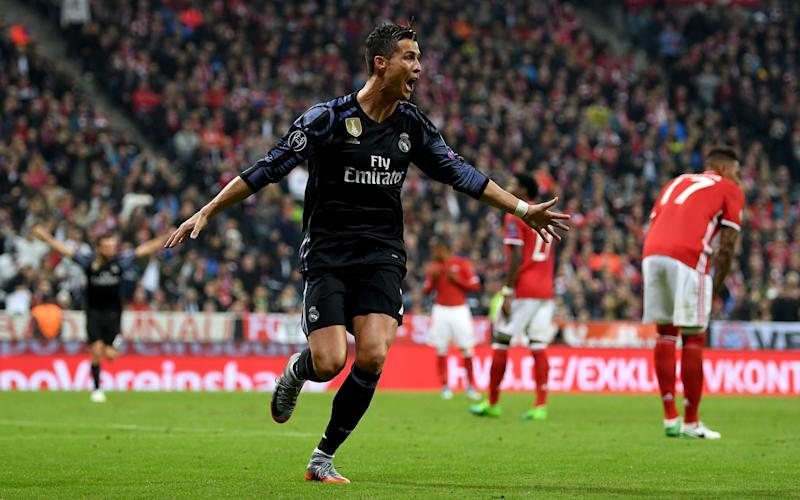 ristiano Ronaldo #7 of Real Madrid celebrates after he scores his team's 2nd goal during the UEFA Champions League Quarter Final first leg match between FC Bayern Muenchen and Real Madrid - 2017 Getty Images