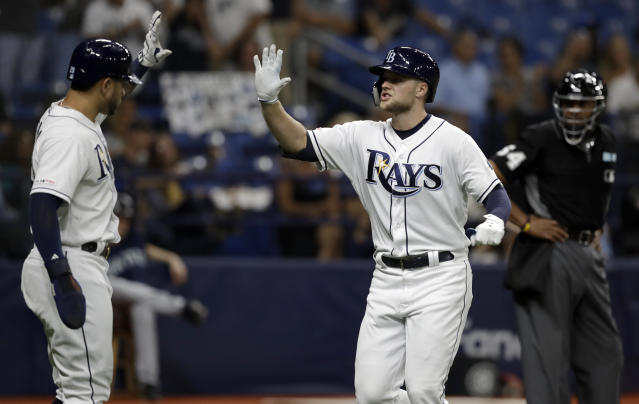 Tampa Bay Rays' Austin Meadows, right, high fives Tommy Pham after Meadows hit a two-run home run off Seattle Mariners starting pitcher Marco Gonzales during the fifth inning of a baseball game Monday, Aug. 19, 2019, in St. Petersburg, Fla. (AP Photo/Chris O'Meara)