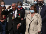 Charles Shay, the 96-year-old native American from Indian Island, Maine, salutes during a D-Day ceremony in Carentan, Normandy, Friday, June 4, 2021. In a small Normandy town where paratroopers landed in the early hours of D-Day, applauds broke the silence to honor Charles Shay. He was the only veteran to attend the ceremony in Carentan commemorating the 77th anniversary of the assault that led to the end World War II. Shay was a 19-year-old U.S. Army medic when he landed on Omaha Beach. (AP Photo/Nicolas Garriga)