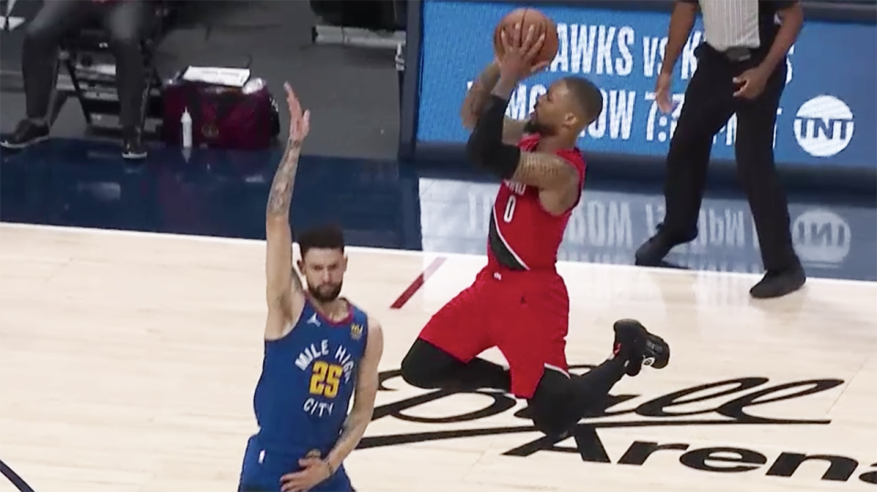 NBA fans erupted after referees called a foul on Denver's Austin Rivers in this play on Portland's Damian Lillard, which led to two overtime periods. Picture: NBA TV