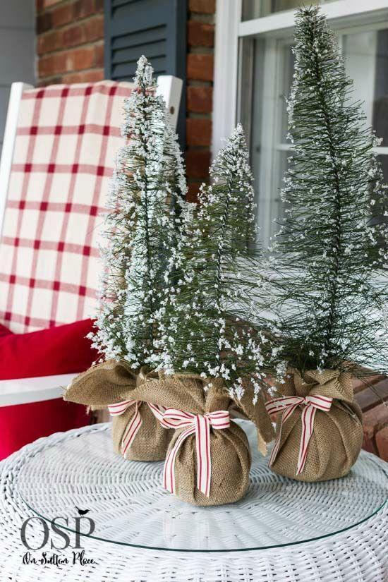 """<p>Towering trees make a dramatic impact at holiday time. But don't sleep on the small ones! Carefully curated clusters of tiny trees adds whimsy and festivity on a Christmas porch.<br></p><p><em><strong>Get the look at <a href=""""https://www.onsuttonplace.com/16150/"""" rel=""""nofollow noopener"""" target=""""_blank"""" data-ylk=""""slk:On Sutton Place"""" class=""""link rapid-noclick-resp"""">On Sutton Place</a>.</strong></em> </p>"""