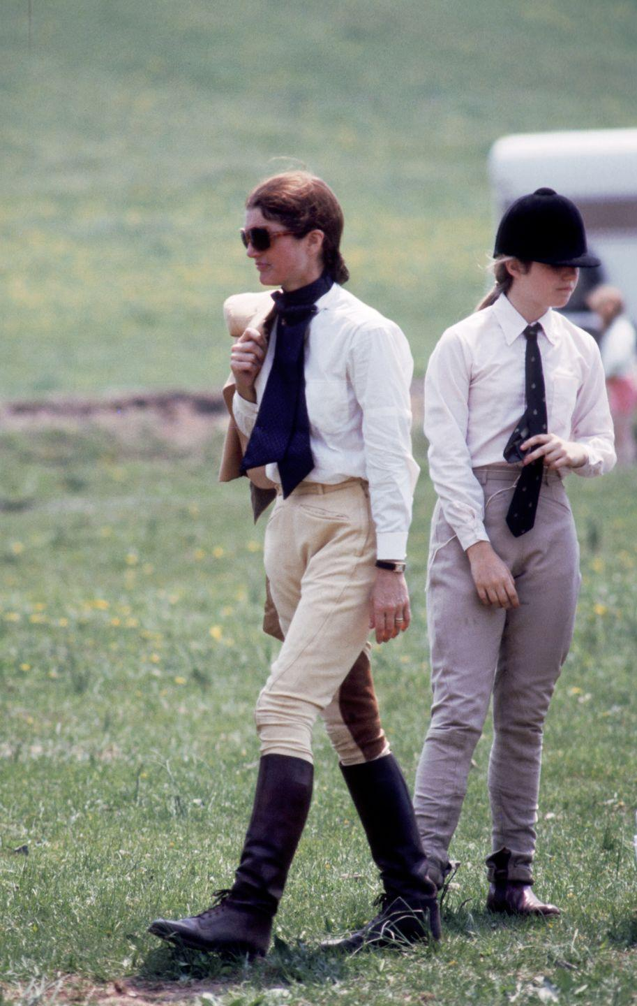<p>Jackie, a life-long equestrian, wears riding gear while at a horse show with her family. </p>