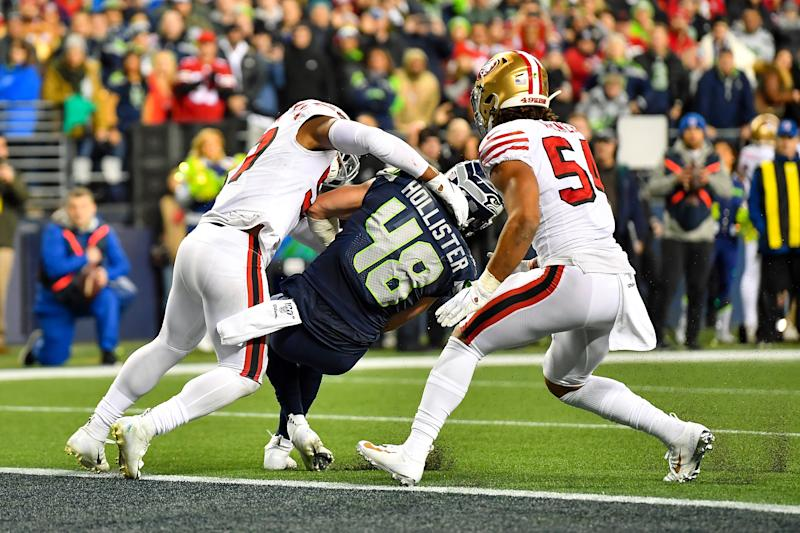 Jacob Hollister of the Seattle Seahawks is stopped inches short of a touchdown by Dre Greenlaw of the San Francisco 49ers in the closing seconds of the regular-season finale. (Photo by Alika Jenner/Getty Images)