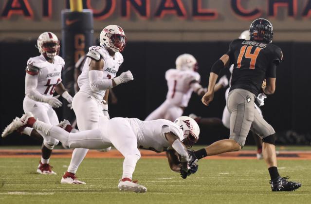 South Alabama linebackers Nick Mobley, left, and Taji Stewart, back center, watch as safety Sterrling Fisher, front center, sacks Oklahoma State quarterback Taylor Cornelius, right, during an NCAA college football game in Stillwater, Okla., Saturday, Sept. 8, 2018. (AP Photo/Brody Schmidt)