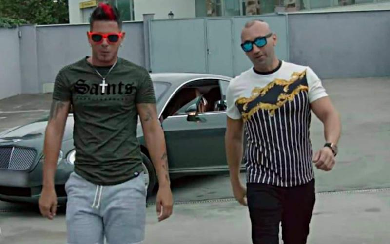 Francisco Tejon, right, appeared in the video with Clase A, getting out of a Bentley Continental before partying with bikini-clad women and bottles of champagne - SOLARPIX.COM