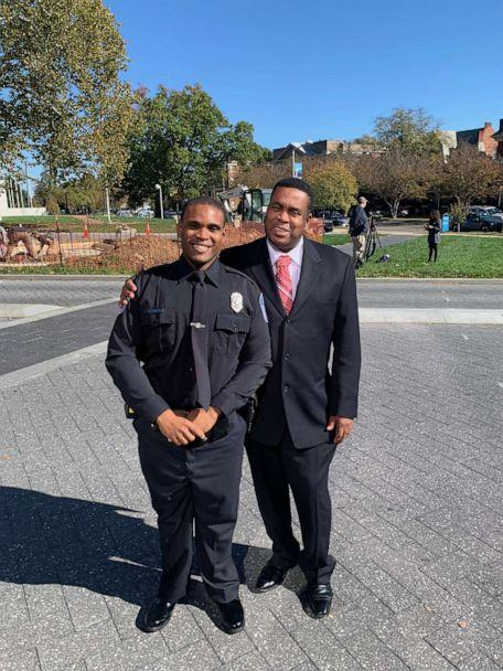 PHOTO: Romar Lyle and his father pose after Lyle's graduation from the police academy. (Courtesy Romar Lyle)