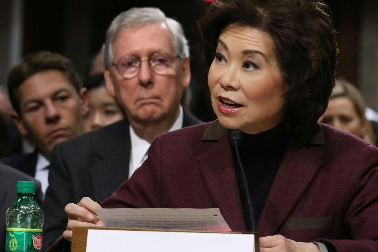 Elaine Chao is pictured on January 10, 2017 during her confirmation hearing to be US Secretary of Transportation as her husband, Senate Majority Leader Mitch McConnell (second from left), looks on