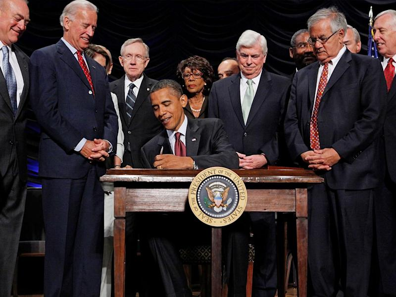 President Obama signs the the financial reform bill into law in 2010 (Getty)