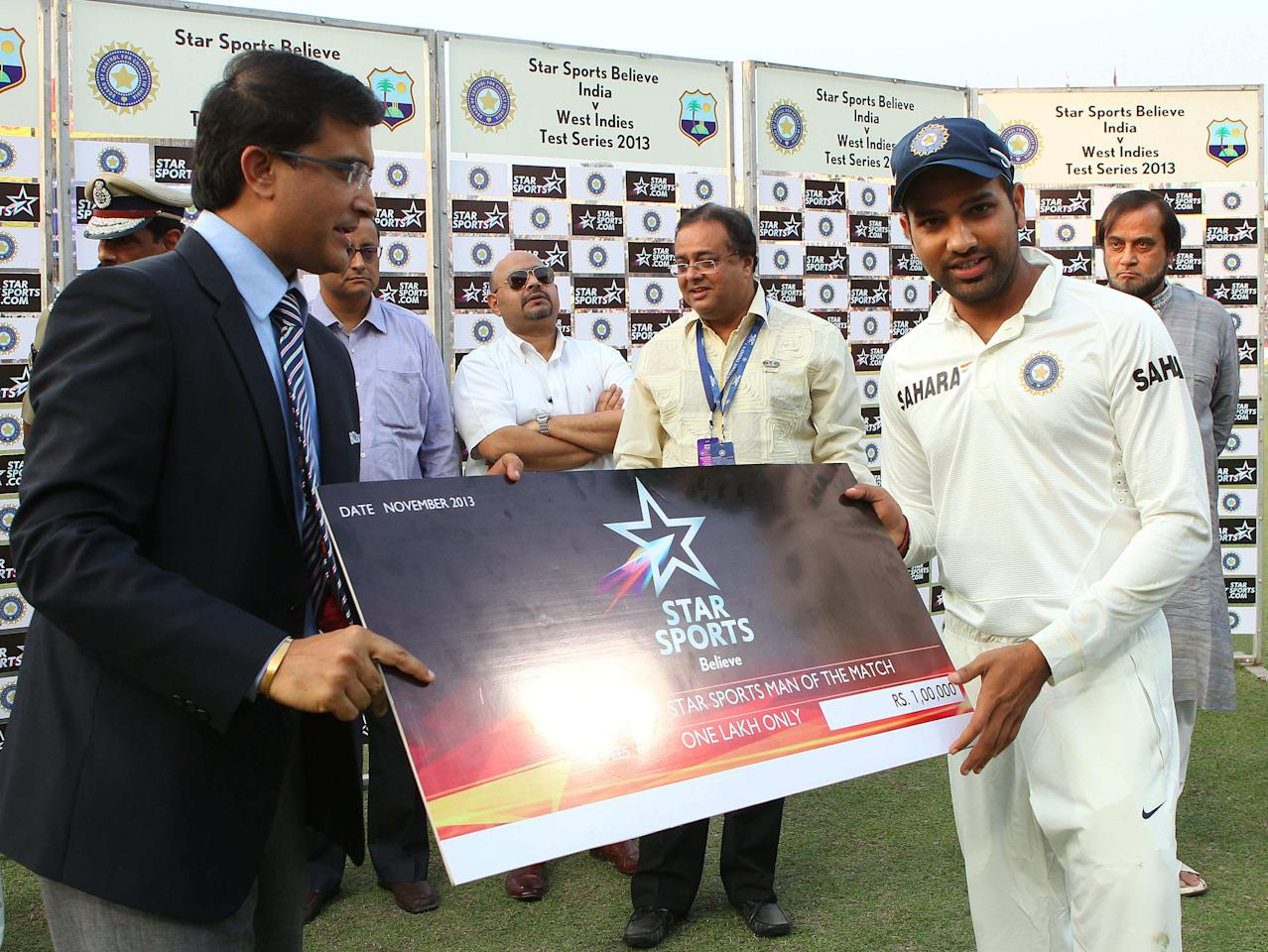 Rohit Sharma of India is man of the match during day three of the first Star Sports test match between India and The West Indies held at The Eden Gardens Stadium in Kolkata, India on the 8th November 2013  Photo by: Ron Gaunt - BCCI - SPORTZPICS