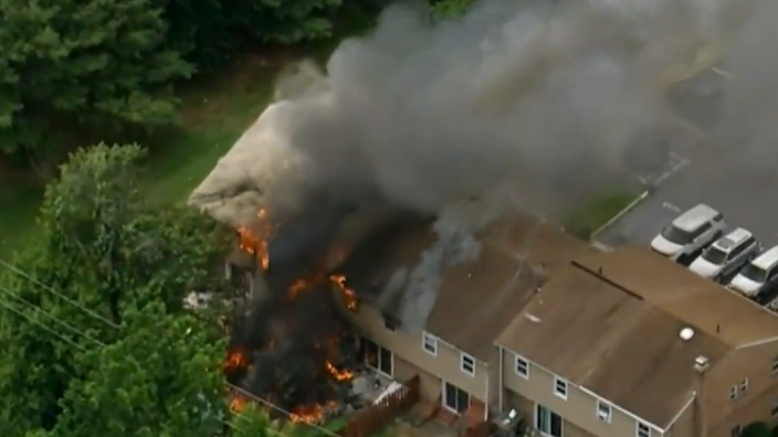 Several townhomes went up in flames after a homeowner allegedly pulled a gun on a local code enforcement officer on Thursday, June 10. / Credit: KYW