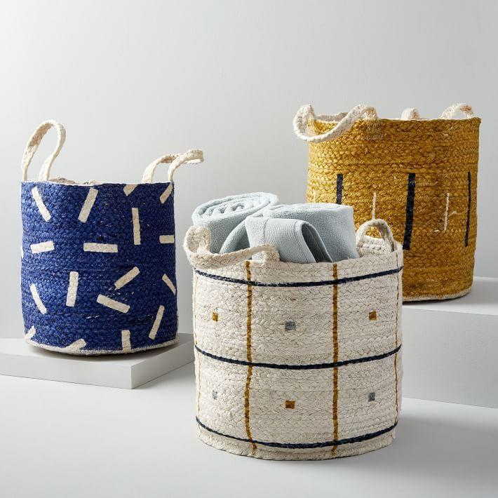 """<p><strong>West Elm</strong></p><p>westelm.com</p><p><a href=""""https://go.redirectingat.com?id=74968X1596630&url=https%3A%2F%2Fwww.westelm.com%2Fproducts%2Fjute-handled-baskets-d6152&sref=https%3A%2F%2Fwww.housebeautiful.com%2Fshopping%2Fg33337693%2Fwest-elm-is-having-a-huge-summer-saleheres-what-to-buy%2F"""" rel=""""nofollow noopener"""" target=""""_blank"""" data-ylk=""""slk:Shop Now"""" class=""""link rapid-noclick-resp"""">Shop Now</a></p><p><del>$39</del><strong><br>$19.99</strong></p><p>Looking for a new chore to take on? Now's a better time than any to Marie Kondo your home. Whether you fill them with blankets, magazines, or toys, you're bound to get a lot of mileage out of these jute baskets.</p>"""