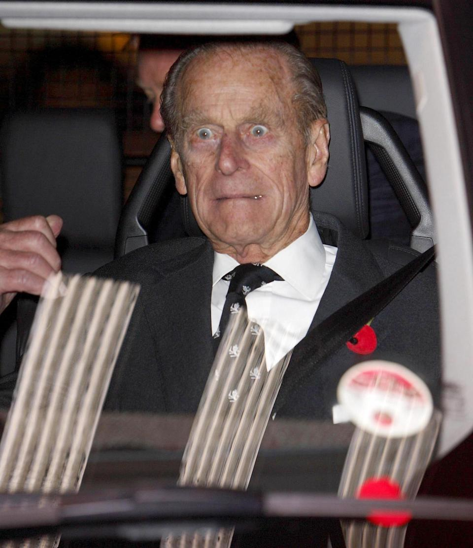 <p>Prince Philip reacts to a blast from the ship's fog horn as he leaves after a visit to the QE2 in Southampton docks. (Photo credit: PA/PA Archive/PA Images) </p>