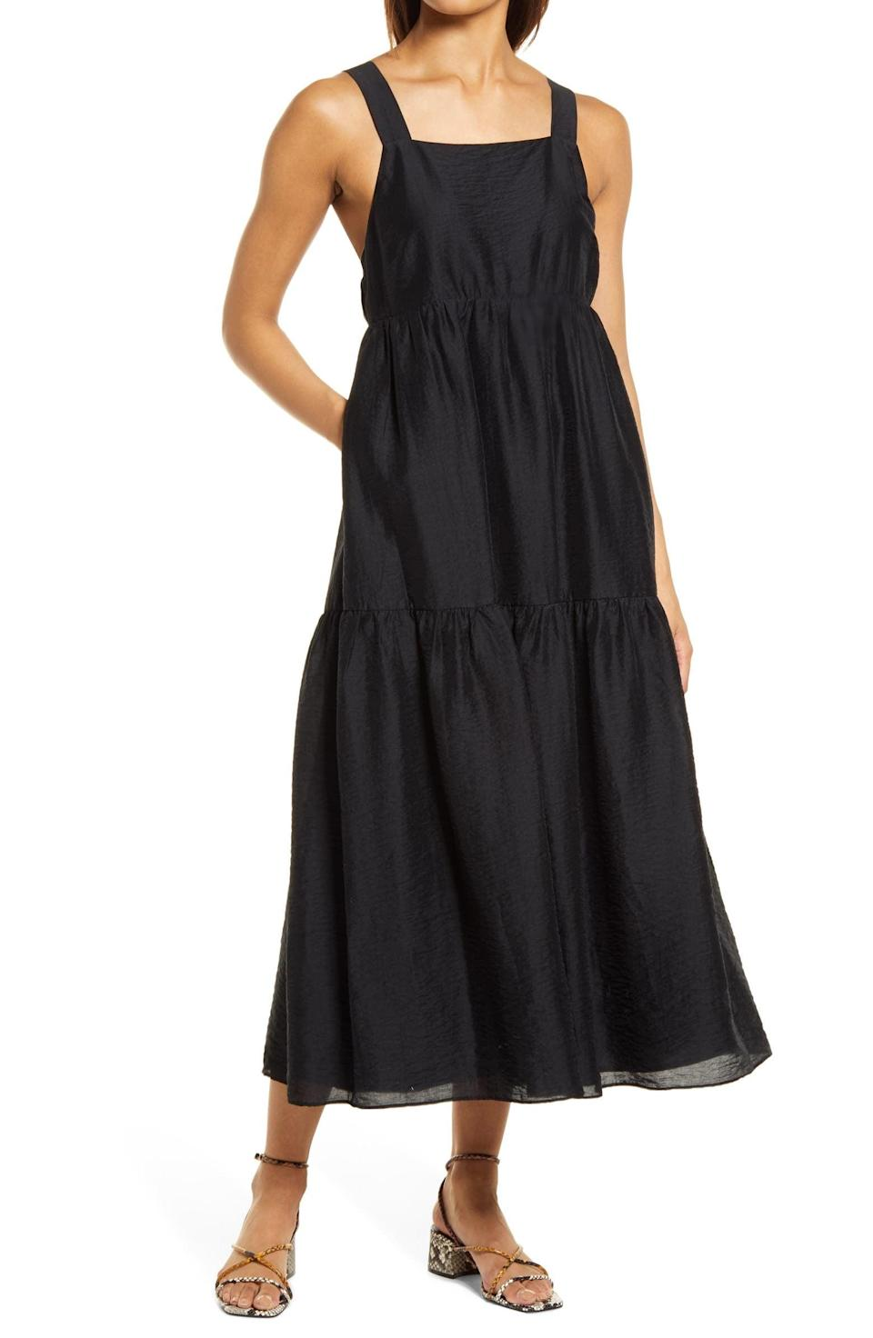 <p>The lustrous fabric of this <span>Halogen Halter Neck Tiered Maxi Dress</span> ($89) makes it suitable for evening wear, but pair it with some slides and it'll absolutely work for daytime activities, too. We love the tiered skirt, which enhances the breezy silhouette.</p>