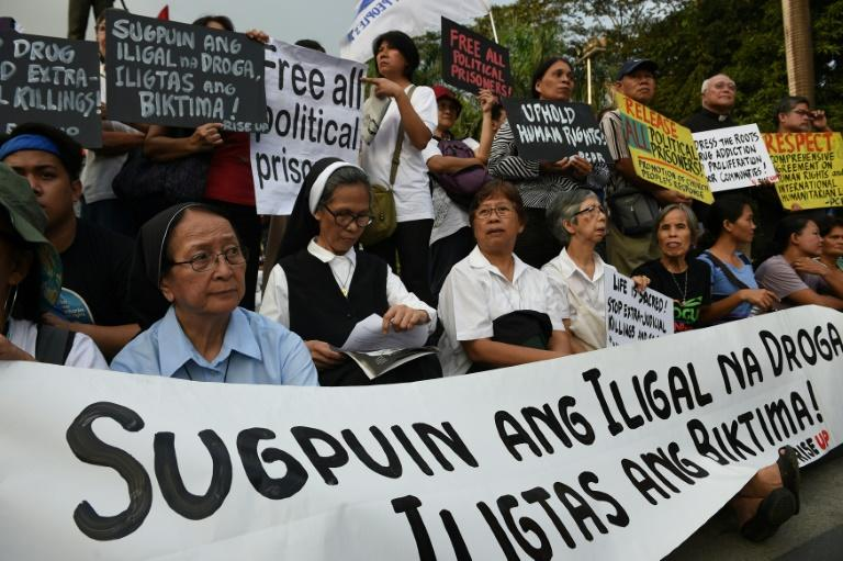 Catholic nuns oppose extra-judicial killings at a Human Rights Day rally in Manila on December 10, 2016