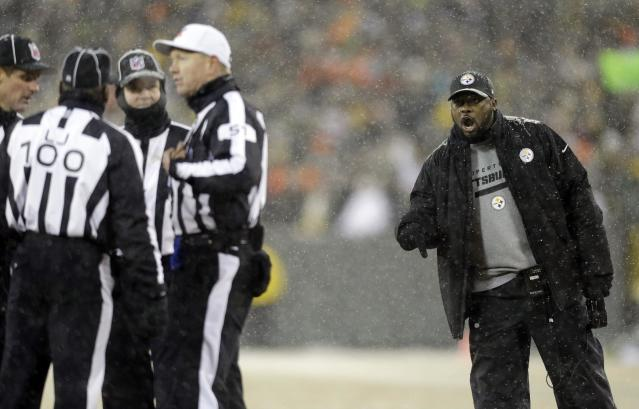 Pittsburgh Steelers head coach Mike Tomlin argues a call during the second half of an NFL football game against the Green Bay Packers Sunday, Dec. 22, 2013, in Green Bay, Wis. (AP Photo/Jeffrey Phelps)