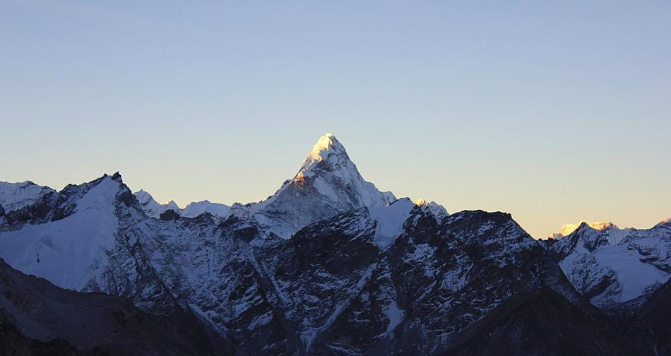 Sunrise over Ama Dablam, Kala Patthar: The walk to Kala Patthar starts before dawn because we want to catch the sunrise from there. I along with my guide Deepak started at 3.15 am. Anyway, I could not sleep at night. I would wake every 15 minutes gasping for breath, so I was happy to get out. The way just goes one way - up. But what a view it was to walk up to! This is a view of first morning light catching up with Ama Dablam.