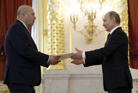 Russian President Putin receives letter of credence from Israeli ambassador to Russia Koren during ceremony at Kremlin in Moscow
