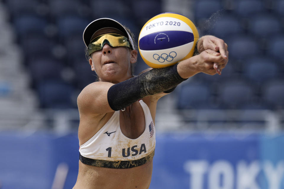 April Ross, of the United States, returns a shot during a women's beach volleyball match against Germany at the 2020 Summer Olympics, Tuesday, Aug. 3, 2021, in Tokyo, Japan. (AP Photo/Felipe Dana)