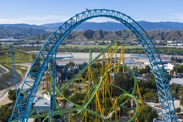 Aerial views of Six Flags Magic Mountain, closed due to the Covid-19 pandemic. A hawk is perched atop the Dive Devil structure near Riddler's Revenge.