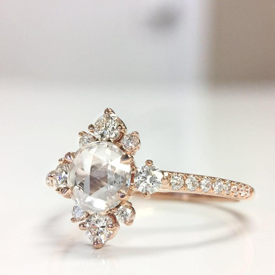 """<p>Diamonds on diamonds on diamonds! The <a href=""""https://www.popsugar.com/buy/Lumiere-Bridal-Parade-Design-530015?p_name=Lumiere%20Bridal%20Parade%20Design&retailer=paradedesign.com&pid=530015&price=3%2C700&evar1=fab%3Aus&evar9=7954958&evar98=https%3A%2F%2Fwww.popsugar.com%2Fphoto-gallery%2F7954958%2Fimage%2F47020644%2FLumiere-Bridal-Parade-Design-Designer-Engagement-Rings&list1=shopping%2Cwedding%2Cjewelry%2Crings%2Cbride%2Cengagement%20rings%2Cfashion%20shopping&prop13=api&pdata=1"""" rel=""""nofollow noopener"""" class=""""link rapid-noclick-resp"""" target=""""_blank"""" data-ylk=""""slk:Lumiere Bridal Parade Design"""">Lumiere Bridal Parade Design</a> ($3,700) features a .50 ct center diamond that's surrounded with a halo of diamonds and a diamond band.</p>"""