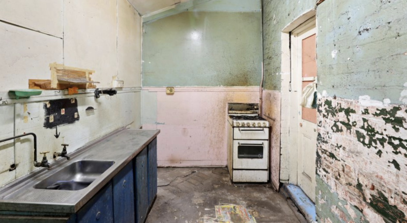 A dilapidated kitchen inside a Waterloo home.