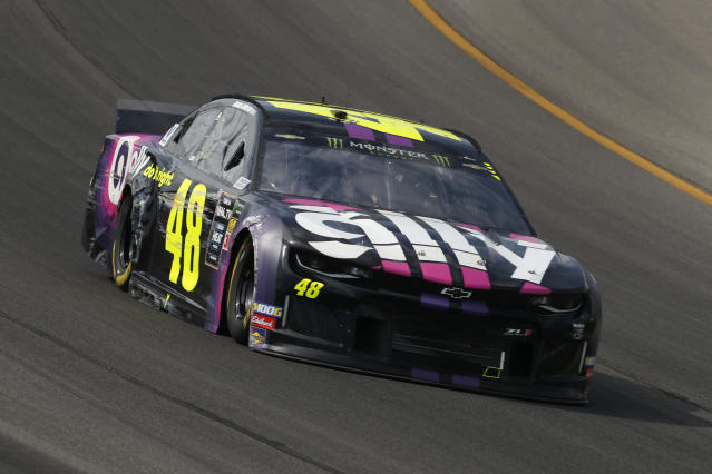 Jimmie Johnson races with damage to his car during a NASCAR Cup Series auto race at Michigan International Speedway in Brooklyn, Mich., Sunday, Aug. 11, 2019. (AP Photo/Paul Sancya)