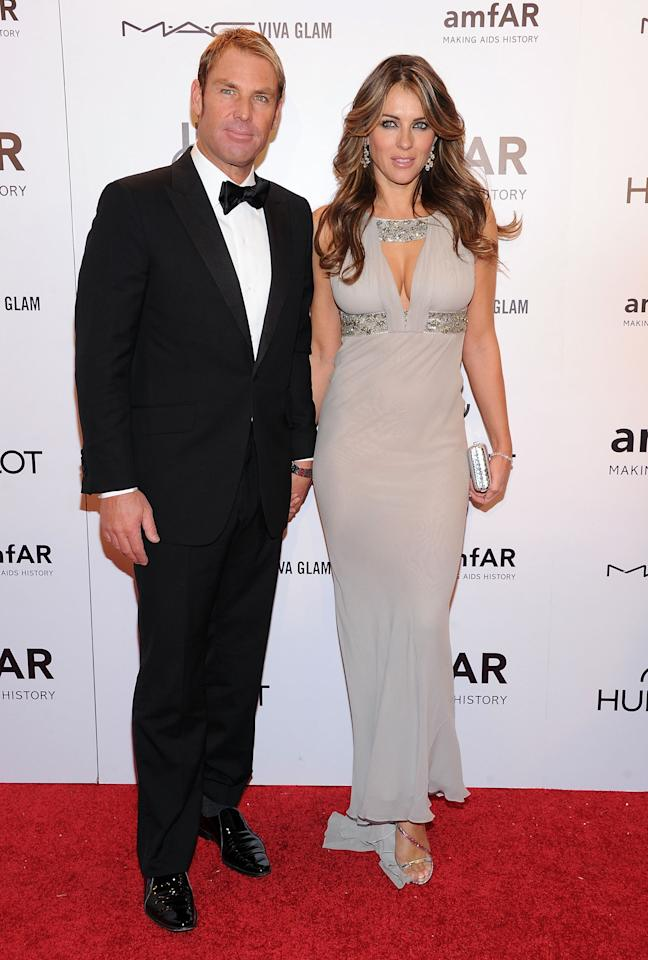 NEW YORK, NY - FEBRUARY 08:  (L-R) Shane Warne and Elizabeth Hurley attends the amfAR New York Gala To Kick Off Fall 2012 Fashion Week Presented By Hublot at Cipriani Wall Street on February 8, 2012 in New York City.  (Photo by Jason Kempin/WireImage)
