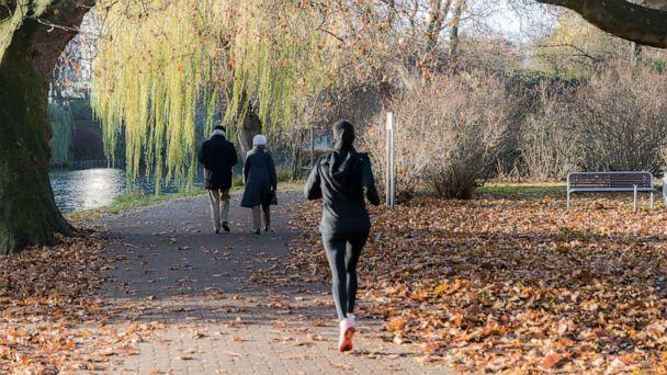 PHOTO: In this undated file photo, people walk and jog in a park. (Reinhard Krull/Eyeem via Getty Images, FILE)