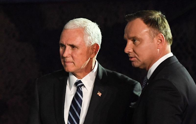 US Vice President Mike Pence (L) stands next to Poland's President Andrzej Duda during a visit at the 1st Airlift Base in Warsaw (AFP Photo/Janek SKARZYNSKI)
