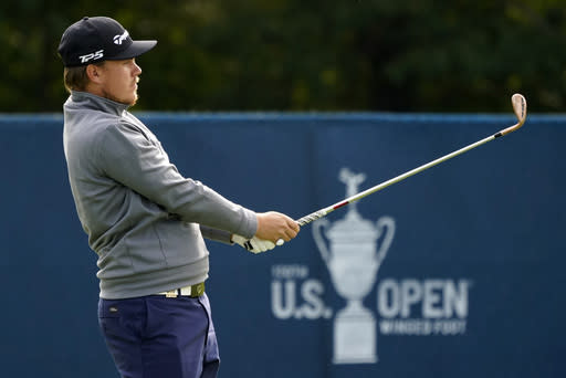 Sami Valimaki, of Finland, watches his shot while practicing for the U.S. Open Championship golf tournament, Tuesday, Sept. 15, 2020, at the Winged Foot Golf Club in Mamaroneck, N.Y. (AP Photo/Charles Krupa)