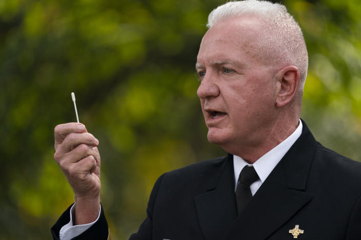 Admiral Brett Giroir, Assistant Secretary for Health, Department of Health and Human Services, shows a nasal swab during a coronavirus testing event with President Donald Trump, in the Rose Garden of the White House, Monday, Sept. 28, 2020, in Washington. (AP Photo/Evan Vucci)