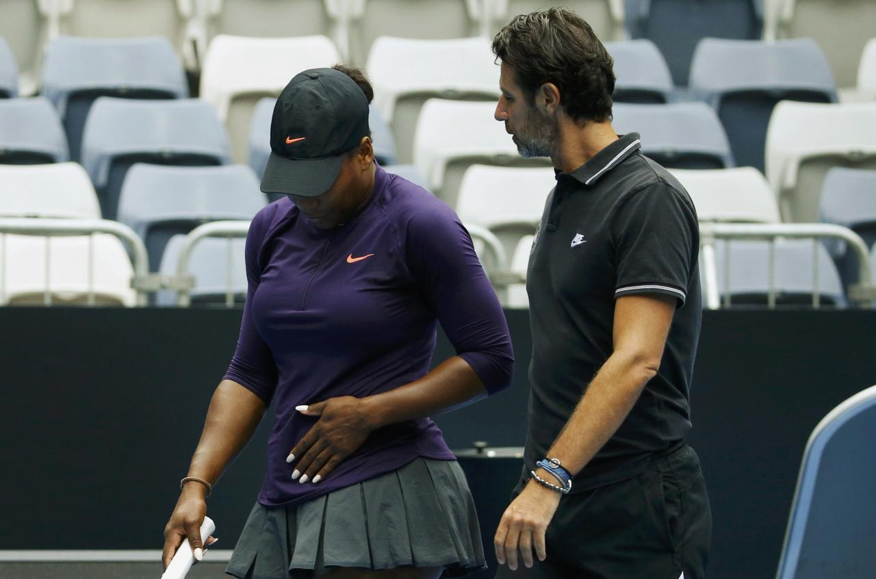 Serena Williams of the U.S. reacts next to her coach Patrick Mouratoglou during a training session ahead of the Australian Open tennis tournament in Melbourne, Australia, January 15, 2017. REUTERS/Edgar Su