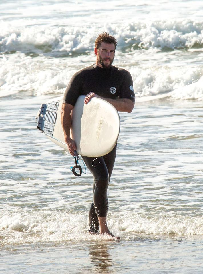 <p>Liam Hemsworth was spotted surfing with his brothers Liam and Luke Hemsworth in Byron Bay, Australia.</p>