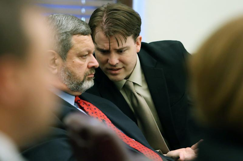 Brett T. Seacat, right, talks with his attorney, Roger Falk, during the prosecution's closing arguments in Seacat's trial on Monday, June 10, 2013, in Kingman, Kan. Seacat is charged with first-degree murder in the shooting death of Vashti Seacat, and aggravated arson and two counts of child endangerment for allegedly setting their house on fire while their young sons slept down the hall. (AP Photo/The Hutchinson News, Travis Morisse, Pool)