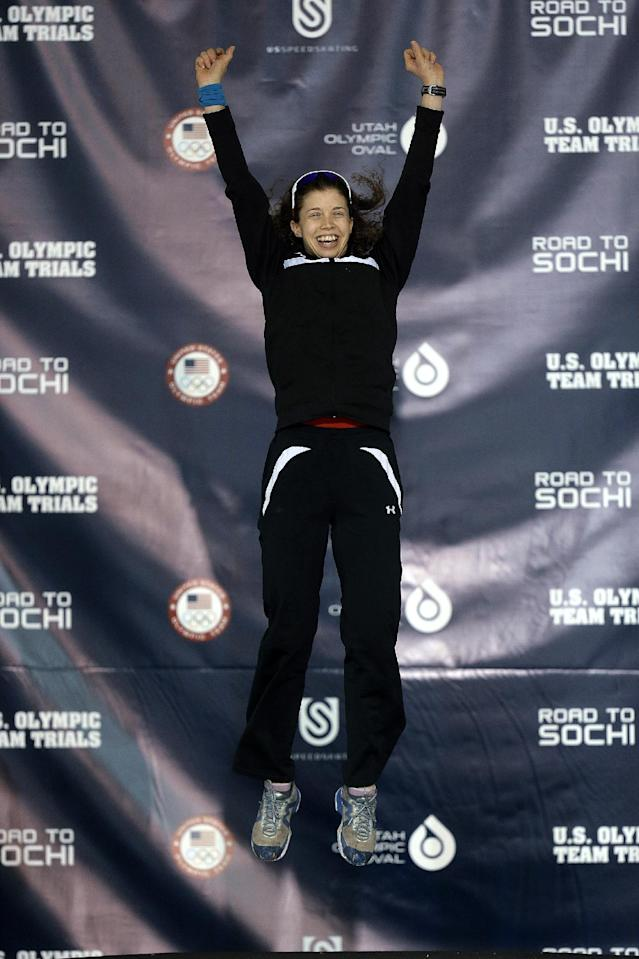 Maria Lamb leaps on the podium after the women's 5,000 meters during the U.S. Olympic speedskating trials Wednesday, Jan. 1, 2014, in Kearns, Utah. (AP Photo/Rick Bowmer)