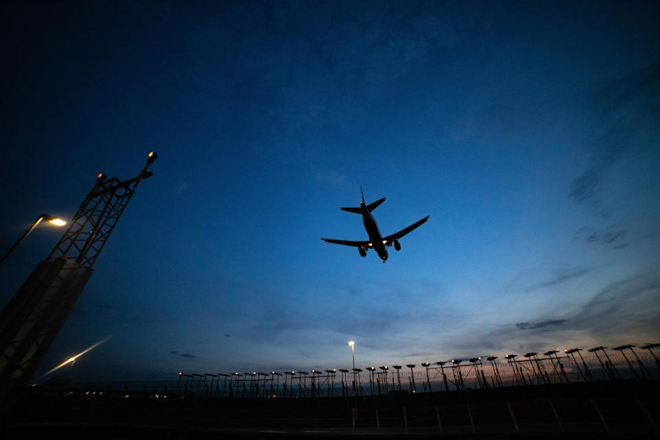 Airplane silhouettes while on final approach landing, during the sunset, dusk and magic hour at the British capital, London Heathrow International Airport EGLL LHR in England, United Kingdom UK. The Boeing and Airbus aircraft are landing on the northern runway over the antennas of the radio navigation instruments. (Photo by Nicolas Economou/NurPhoto via Getty Images)