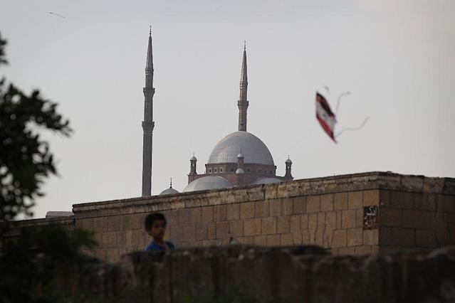 <b>CAIRO, EGYPT:</b> A boy flies a kite in sight of the mosque of Muhammad Ali Pasha on The Citadel of Cairo. This mosque, along with the citadel, is one of the landmarks and tourist attractions of Cairo and is one of the first features to be seen when approaching the city. The mosque was built by Muhammad Ali Pasha, an Albanian commander in the Ottoman army largely considered the founder of modern Egypt, in memory of Tusun Pasha, his oldest son, who died in 1816.
