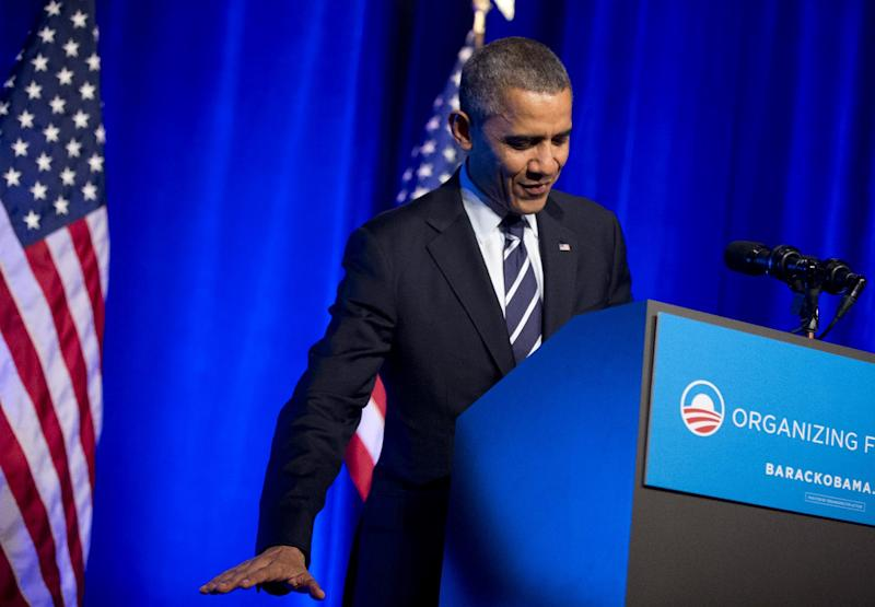 President Barack Obama gestures to describe the height of his children as he speaks at an Organizing for Action event in Washington, Monday, Nov. 4, 2013. (AP Photo/Manuel Balce Ceneta)