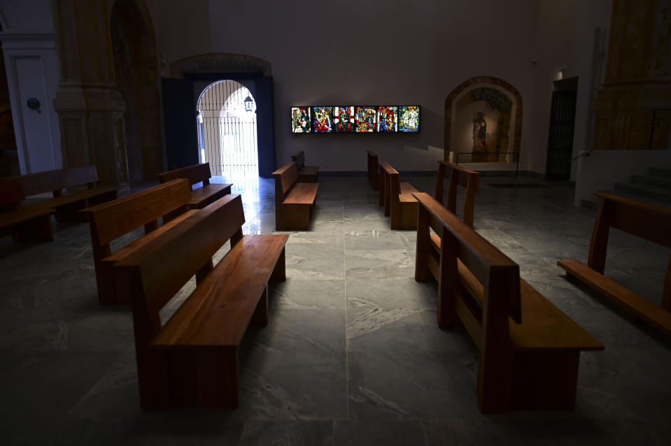Pews stand in the San Jose Church as it reopens after reconstrution in San Juan, Puerto Rico, Tuesday, March 9, 2021. The second oldest in age only to the Spanish cathedral in the neighboring Dominican Republic, it was shuttered in 1996 due to serious deterioration. (AP Photo/Carlos Giusti)