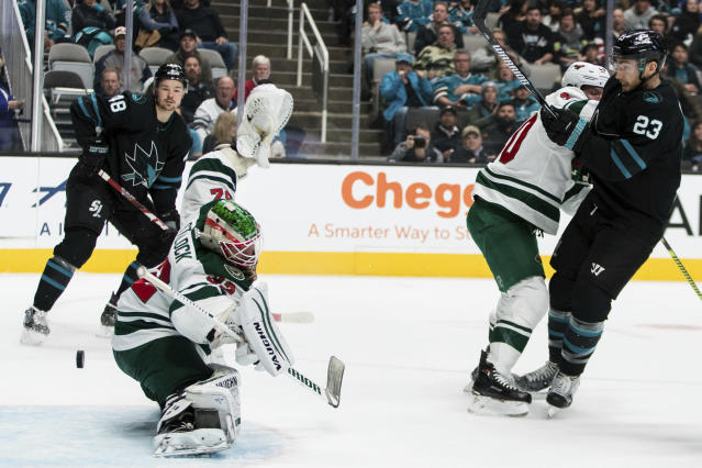 San Jose Sharks' Barclay Goodrow (23) and Minnesota Wild's Jared Spurgeon (46) watch the puck go past Minnesota Wild goaltender Alex Stalock to score on a shot by Sharks' Radim Simek, not seen, during the first period of an NHL hockey game Thursday, Nov. 7, 2019, in San Jose, Calif. (AP Photo/John Hefti)