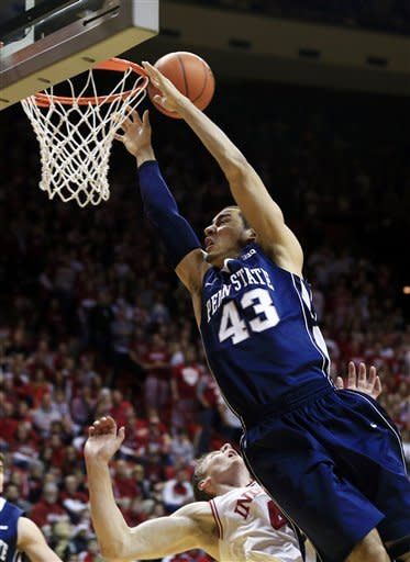 Indiana's Cody Zeller, bottom left, is called for a foul against Penn State's Ross Travis during the first half of an NCAA college basketball game, Wednesday, Jan. 23, 2013, in Bloomington, Ind. (AP Photo/Darron Cummings)