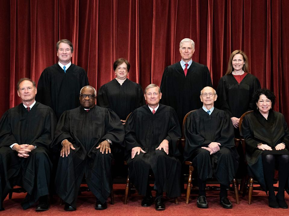 Seated from left: Associate Justice Samuel Alito, Associate Justice Clarence Thomas, Chief Justice John Roberts, Associate Justice Stephen Breyer and Associate Justice Sonia Sotomayor, standing from left: Associate Justice Brett Kavanaugh, Associate Justice Elena Kagan, Associate Justice Neil Gorsuch and Associate Justice Amy Coney Barrett pose during a group photo of the Justices at the Supreme Court in Washington, DC on 23 April 2021 (ERIN SCHAFF/POOL/AFP via Getty Images)