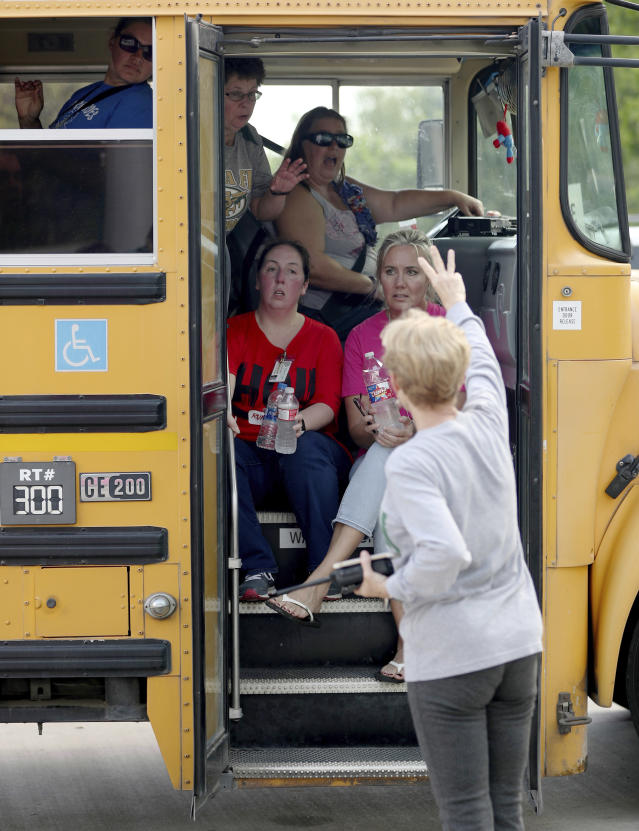 <p>School staff members sit in a school bus to be transported to another school after a shooting at the Santa Fe High School in Santa Fe, Texas, on Friday morning, May 18, 2018. (Photo: Jennifer Reynolds/The Galveston County Daily News via AP) </p>