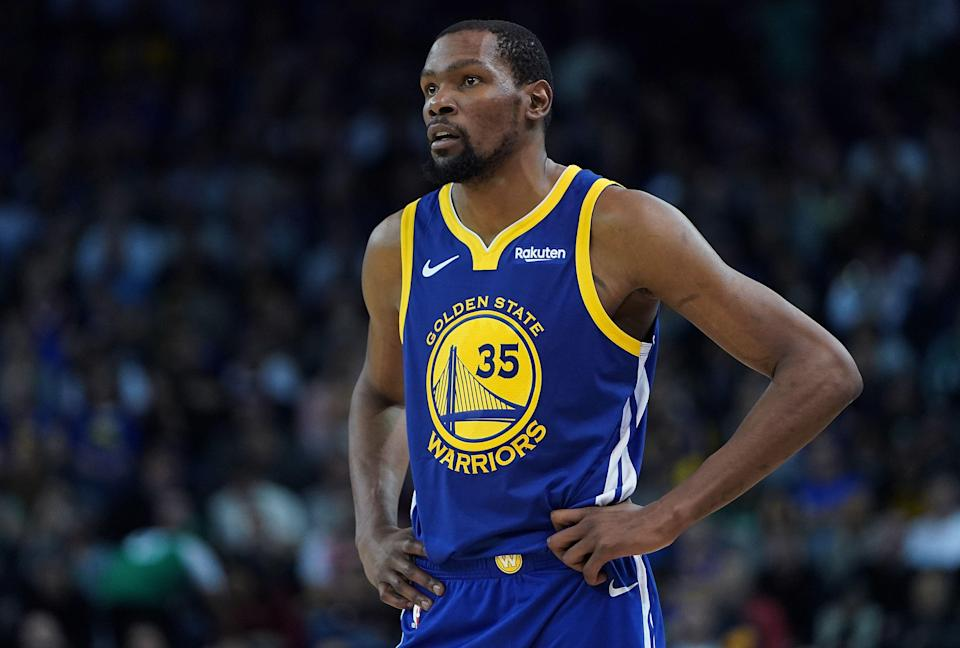 OAKLAND, CA - MARCH 05:  Kevin Durant #35 of the Golden State Warriors looks on against the Boston Celtics during an NBA basketball game at ORACLE Arena on March 5, 2019 in Oakland, California. NOTE TO USER: User expressly acknowledges and agrees that, by downloading and or using this photograph, User is consenting to the terms and conditions of the Getty Images License Agreement.  (Photo by Thearon W. Henderson/Getty Images)