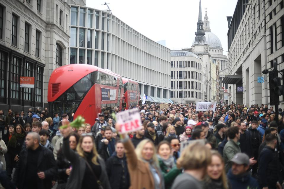 People taking part in an anti-lockdown protest in central London. Picture date: Saturday March 20, 2021.