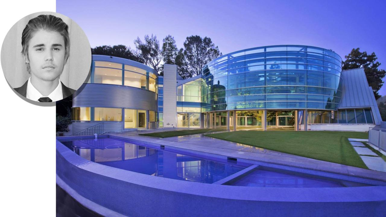 "Just because Bieber's renting, doesn't mean he isn't paying a pretty penny for this posh Beverly Hills pad. It's known as the ""Salad Spinner house"" and has six-bedroom, seven bathrooms, a seven-car garage, infinity pool, and a glass-enclosed yard. It's situated on almost an acre of land, which means that neighbors may not be as bothered by the singer's antics as they were when he lived in Calabasas."