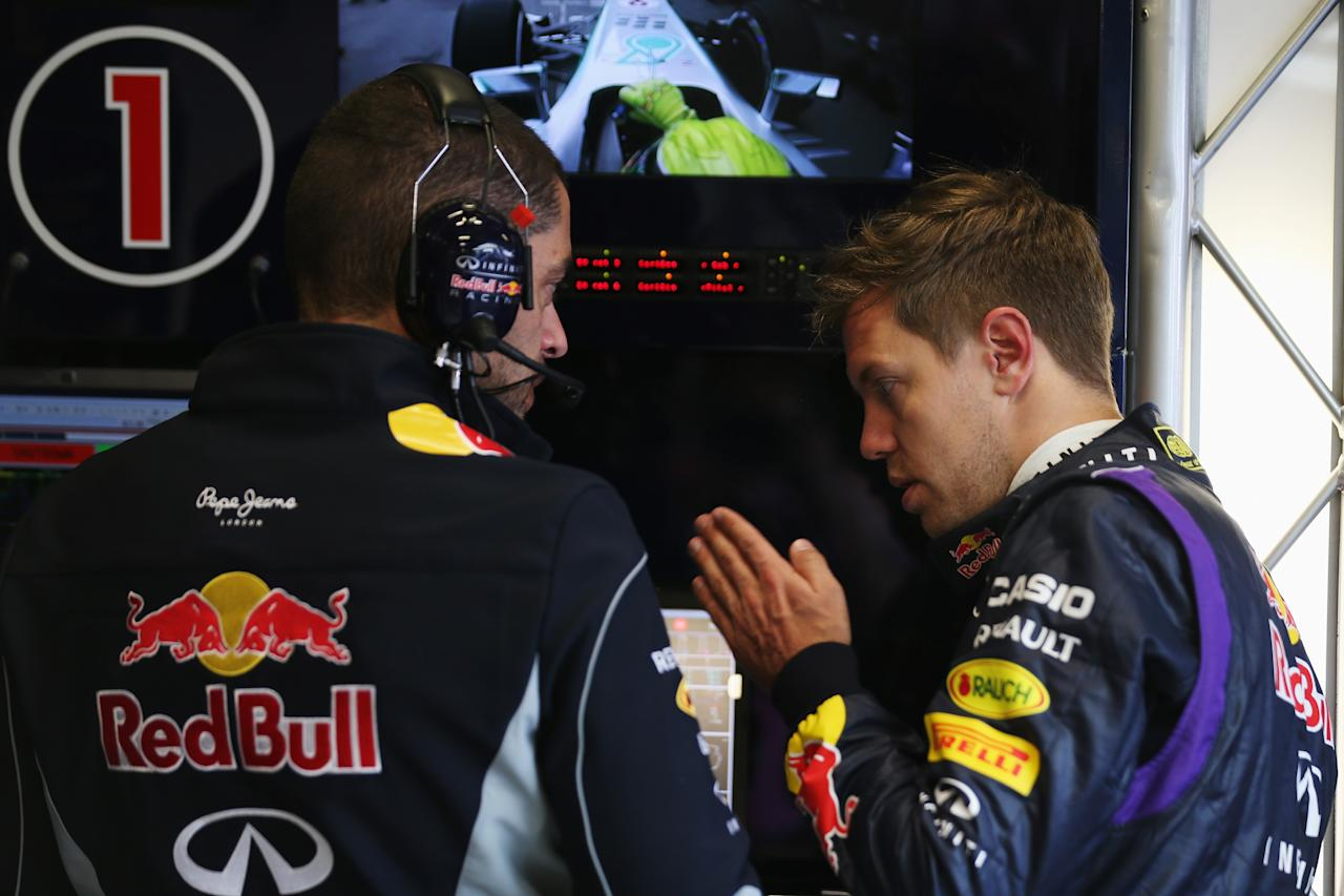 MELBOURNE, AUSTRALIA - MARCH 15:  Sebastian Vettel of Germany and Infiniti Red Bull Racing talks with his race engineer Guillaume Rocquelin during practice for the Australian Formula One Grand Prix at the Albert Park Circuit on March 15, 2013 in Melbourne, Australia.  (Photo by Mark Thompson/Getty Images)