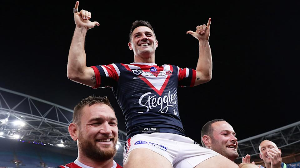 Cooper Cronk, pictured here after winning the 2019 NRL grand final with the Roosters.