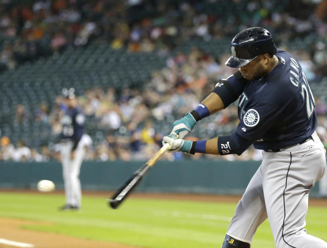 Seattle Mariners' Robinson Cano connects for an RBI double against the Houston Astros in the first inning of a baseball game Tuesday, July 1, 2014, in Houston. (AP Photo/Pat Sullivan)